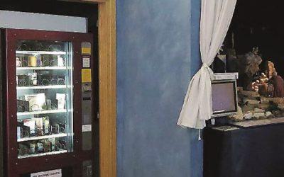 Distributore automatico di santini e preghiere